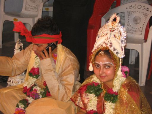 Pradeepto's on the phone during the wedding ceremony
